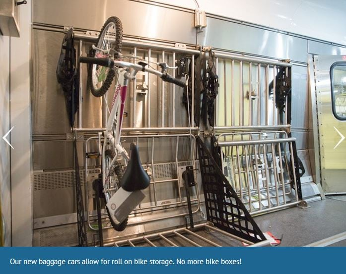 A bike hangs on a rack in an amtrak luggage car