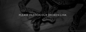 Broken bicycle chain with text: Please pardon our broken link.