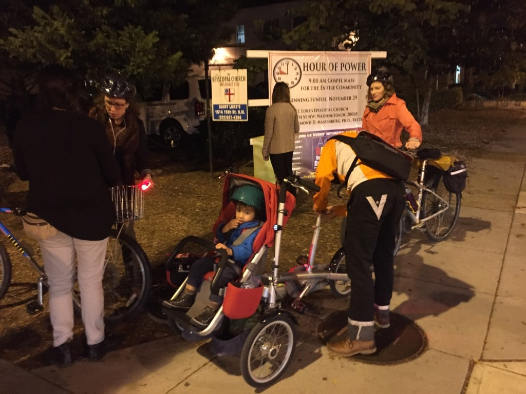 DC Bike Ambassadors stop bicyclists on the 15th street cycletrack