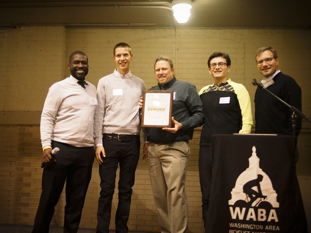 Accepting the award was Phil Koopmen, Co-Owner of BicycleSPACE, and BicycleSPACE staff.