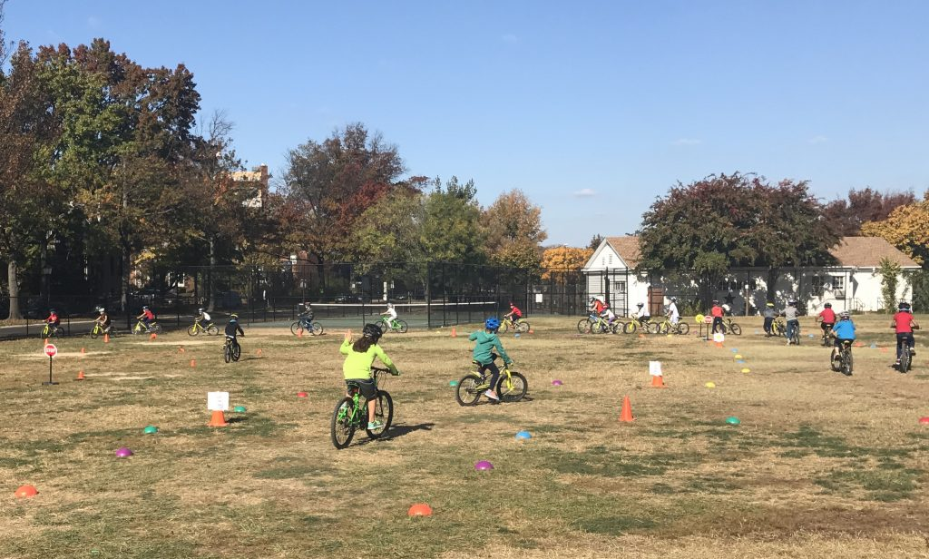 youth on bikes in PE class in Alexandria