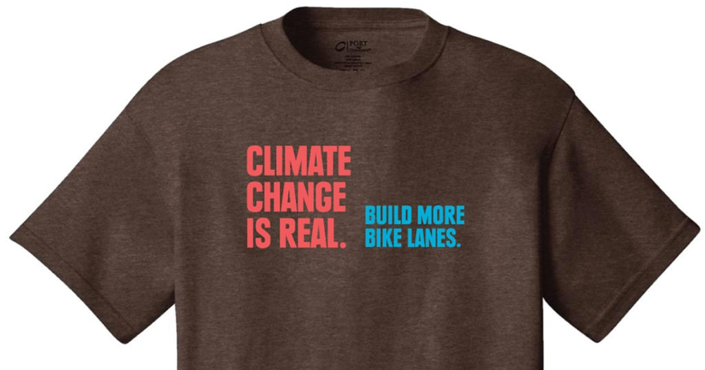 "A t-shirt that says ""Climate change is real. Build more bike lanes."""