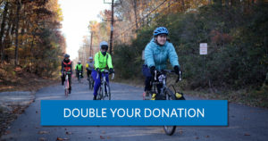 """a group of women riding on a trail. A button reads """"double your donation"""""""