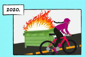 """A woman with a long braid biking up a hill. On the side of the road, a dumpster is engulfed in flames. The caption reads """"2020."""""""